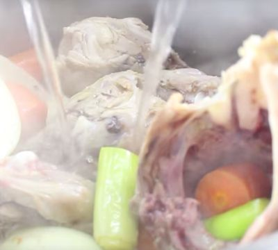 adding water to chicken stock