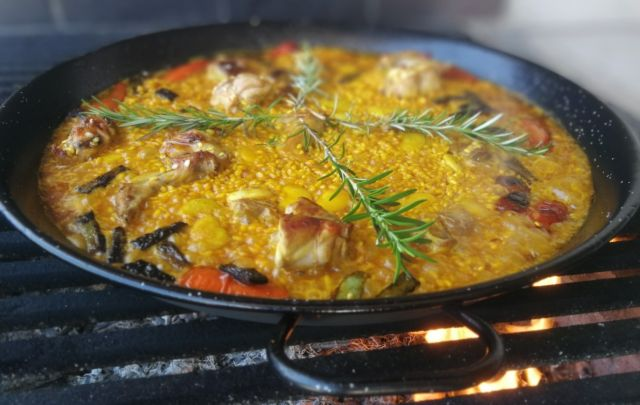 This image has an empty alt attribute; its file name is authentic-paella-boiling.jpg