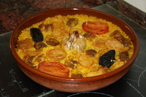 Baked paella in a clay casserole