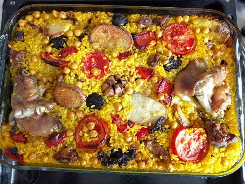 Baked paella in a glass casserole